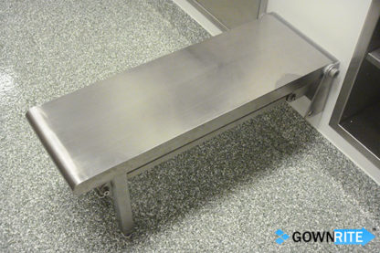 GownRite™ Stainless Steel Wall-Mounted Flip-Down Gowning Bench shown installed and folded down ready for use