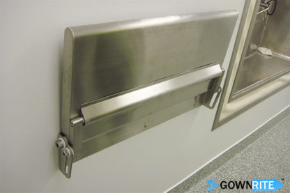GownRite™ Stainless Steel Wall-Mounted Flip Down Table shown installed and flipped up and stowed