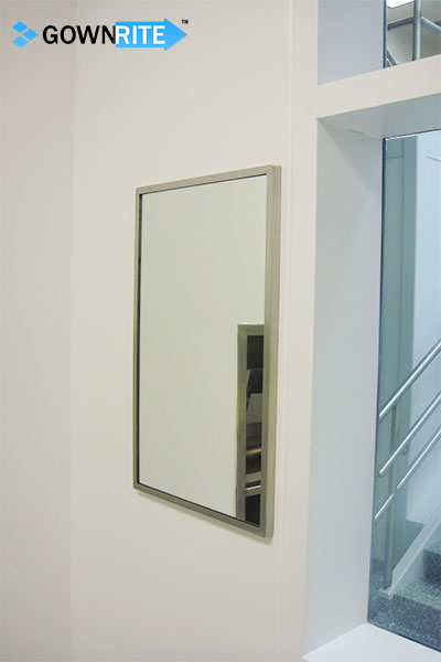 GownRite™ Stainless Steel Wall-Mounted Gowning Mirror shown installed in gowning room